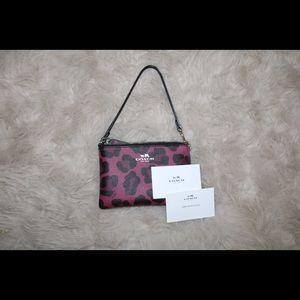 Pink Cheetah Print Coach Wristlet